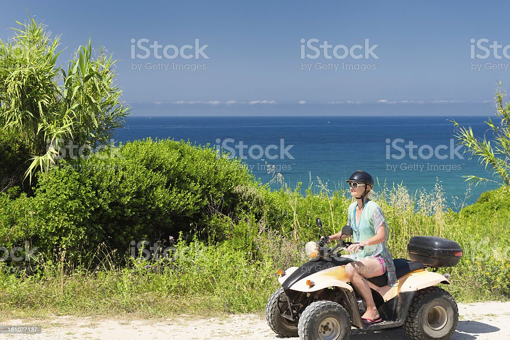 Driving quadbike by the sea royalty-free stock photo
