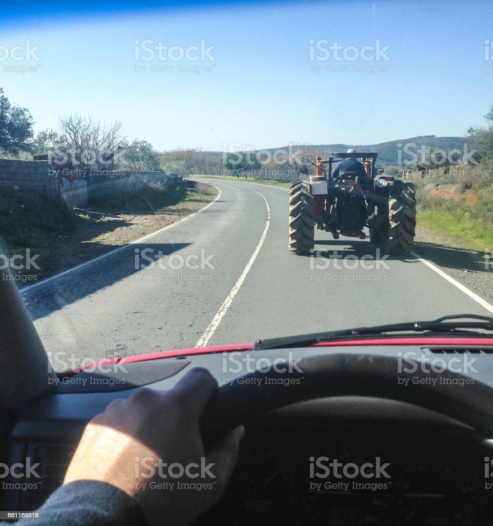 Driving slow behind a tractor foto de stock libre de derechos