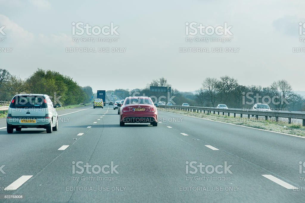 Driving south on the M6 motorway in the middle lane stock photo