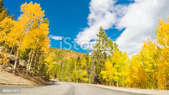 POV point of view - Driving through alpine forest of Guanella Pass in Colorado in the Autumn.