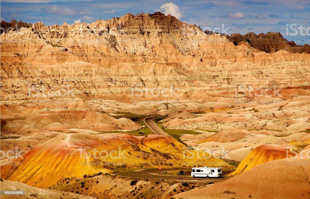 RV driving through Badlands National Park zbiór zdjęć royalty-free