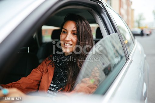 Young commuter woman driving in Berlin Mitte.