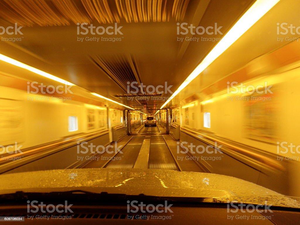 Driving through car transporter stock photo