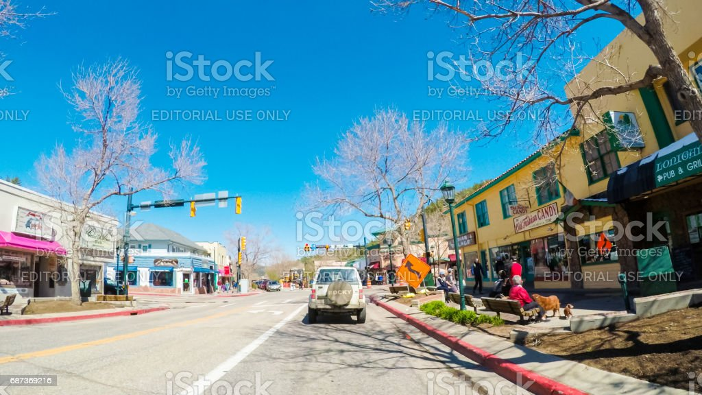 Driving through downtown of Estes park in the Spring. stock photo