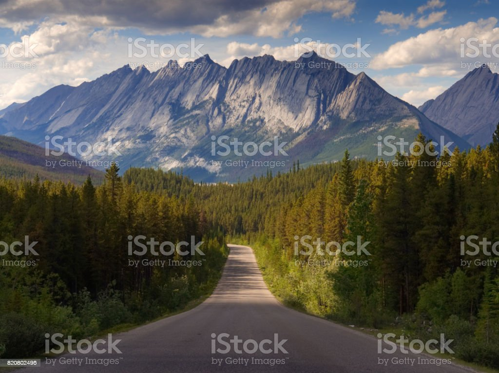 Driving Through Jasper National Park towards the Rocky Mountains stock photo