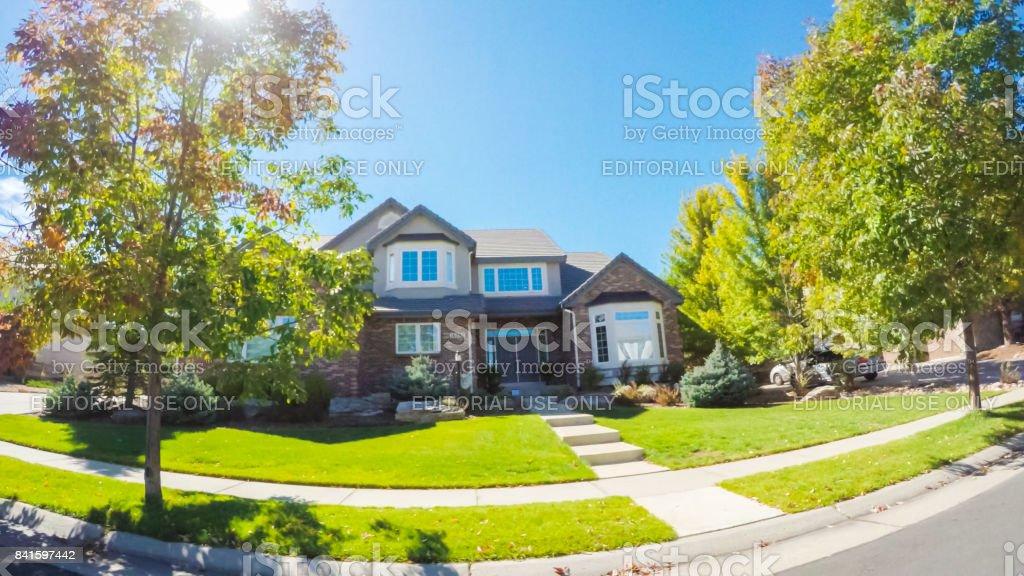 Driving through residential neighborhood in suburbia. stock photo
