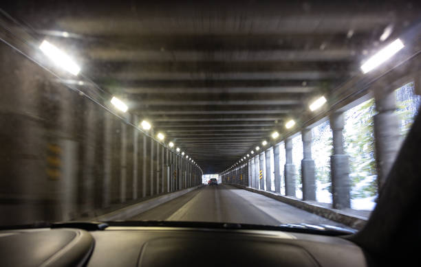 driving through roger's pass tunnel - british columbia glacier national park stock pictures, royalty-free photos & images