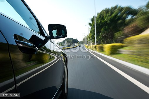 688980174istockphoto driving through the city 472186747