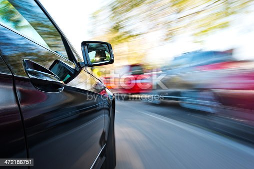 688980174istockphoto driving through the city 472186751