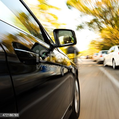 688980174istockphoto driving through the city 472186763