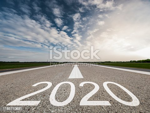 1170070487 istock photo Driving to upcoming 2020 on Empty asphalt road 1185710631