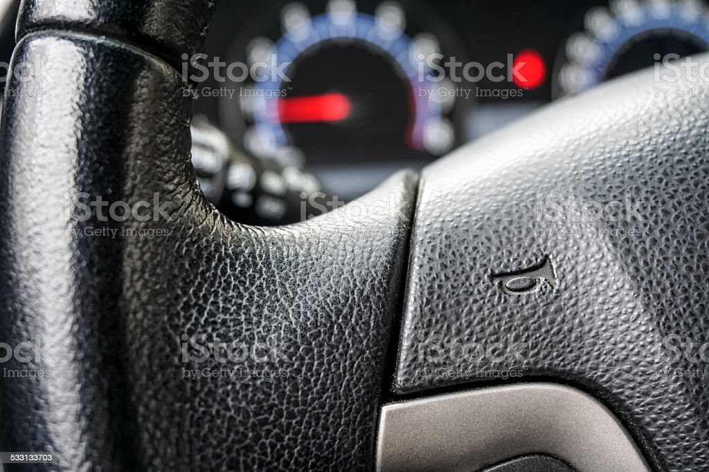 driving wheel whith horn sign stock photo