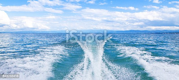 Wake of a motor boat on lake Bodensee, Germany