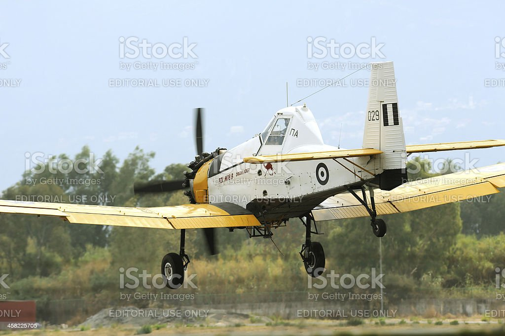 PZL M18 B Dromader airplane in low terrain flight stock photo