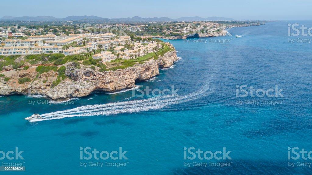 Drone aerial landscape of the beautiful bay of Cala Estany d'en Mas with a wonderful turquoise sea, Cala Romantica, Porto Cristo, Majorca, Spain stock photo