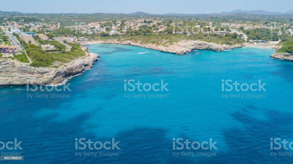 Drone aerial landscape of the beautiful bay of Cala Mandia and Anguila with a wonderful turquoise sea, Porto Cristo, Majorca, Spain stock photo