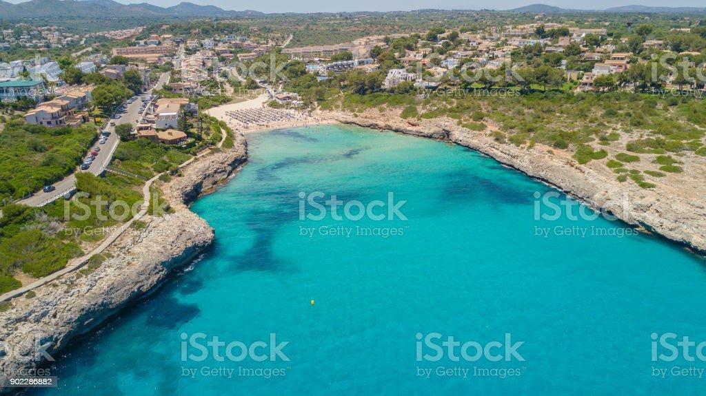 Drone aerial landscape of the beautiful bay of Cala Mandia with a wonderful turquoise sea, Porto Cristo, Majorca, Spain stock photo