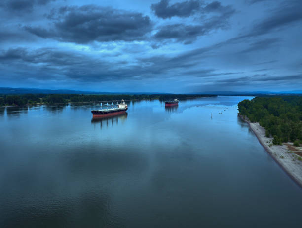 Drone Aerial of 2 cargo ships on the Columbia River on a cloudy summer day stock photo