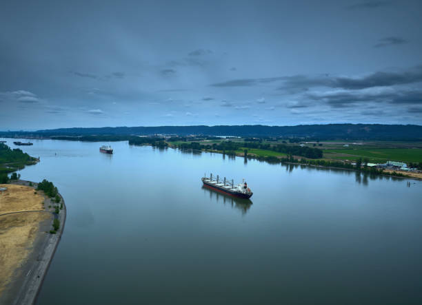 Drone Aerial of 2 cargo ships on the Columbia River on a summer day stock photo