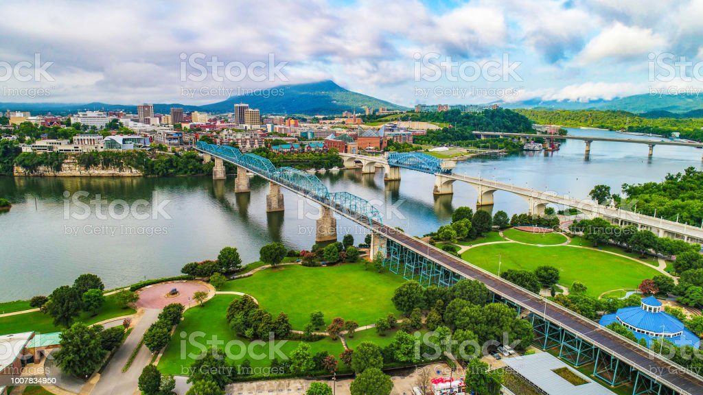 Drone Aerial of Downtown Chattanooga Tennessee Skyline Drone Aerial of Downtown Chattanooga TN Skyline, Coolidge Park and Market Street Bridge. Aquarium Stock Photo