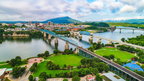 Drone Aerial of Downtown Chattanooga Tennessee Skyline Drone Aerial of Downtown Chattanooga TN Skyline, Coolidge Park and Market Street Bridge. tennessee stock pictures, royalty-free photos & images