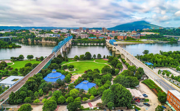 Drone Aerial of Downtown Chattanooga Tennessee TN Skyline Drone Aerial of Downtown Chattanooga TN Skyline, Coolidge Park and Market Street Bridge. chattanooga stock pictures, royalty-free photos & images