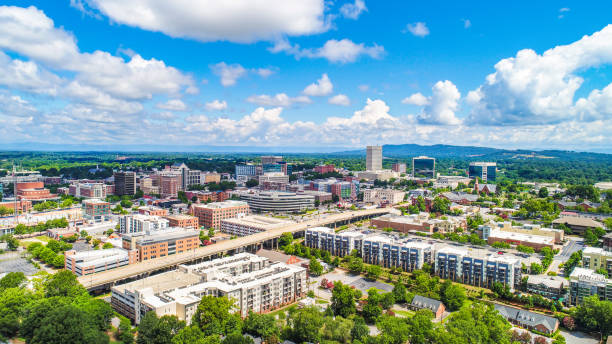 Drone Aerial of Downtown Greenville South Carolina Drone Aerial of Main Street Downtown Greenville South Carolina Skyline. spartanburg stock pictures, royalty-free photos & images