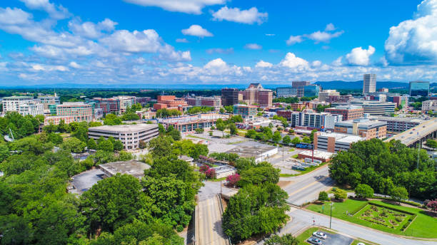 Drone Aerial of Downtown Greenville South Carolina Skyline Drone Aerial of Main Street Downtown Greenville South Carolina Skyline. spartanburg stock pictures, royalty-free photos & images