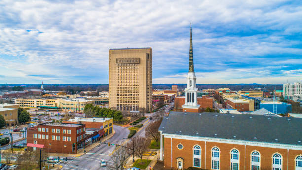 Drone Aerial of Downtown Spartanburg, South Carolina, USA. Drone Aerial of Main Street in Downtown Spartanburg, South Carolina, USA. spartanburg stock pictures, royalty-free photos & images