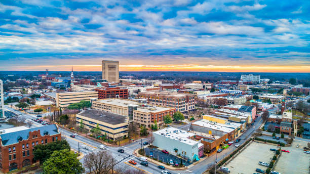 Drone Aerial of Downtown Spartanburg, South Carolina, USA Drone Aerial of Main Street in Downtown Spartanburg, South Carolina, USA. spartanburg stock pictures, royalty-free photos & images