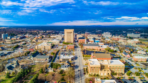 Drone Aerial of Main Street in Downtown Spartanburg, South Carolina, USA Drone Aerial of Main Street in Downtown Spartanburg, South Carolina, USA. spartanburg stock pictures, royalty-free photos & images