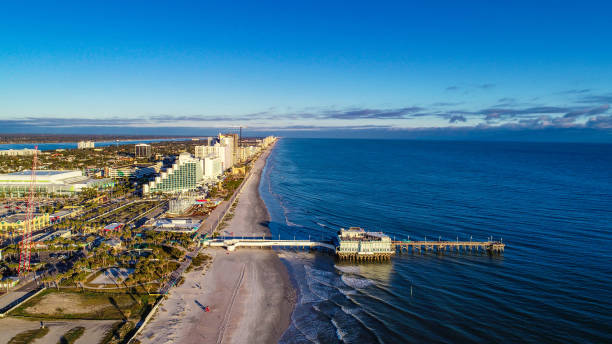 drone aerial of pier in daytona beach, florida, usa - daytona 500 stock photos and pictures