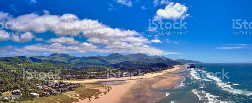 Drone aerial panorama 350 feet above Cannon Beach with Haystack Rock on a summer day stock photo