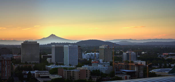 Drone aerial panorama at sunrise looking over the top of the MODA Center with Mt Hood in the background stock photo