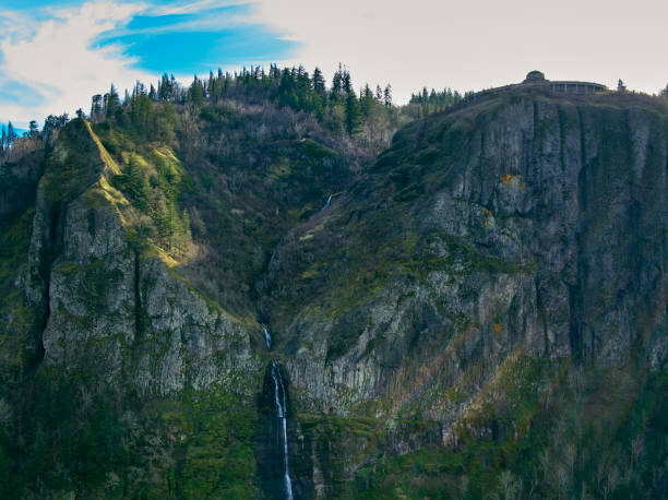 Drone aerial panorama of the front cliffs below Crown Point-Vista House with a small waterfall in the Columbia River Gorge stock photo