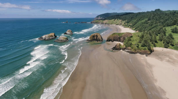 Drone aerial panorama shot at approximately 400 feet above Cannon Beach looking towards Ecola State Park in the summer on the Oregon Coast stock photo