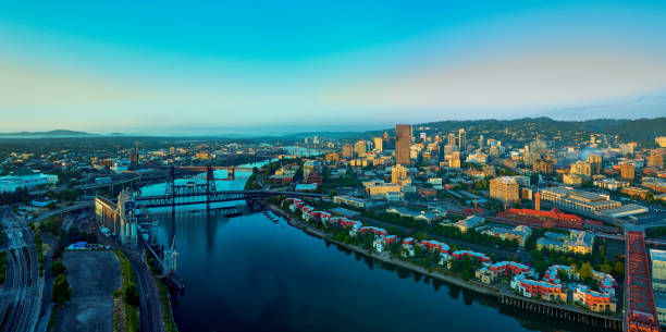 Drone aerial panorama sunrise over downtown Portland with 6 bridges and the Willamette River stock photo