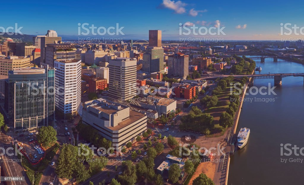 Drone aerial view of downtown Portland showing the World Trade Center Portland from Waterfront Park in early morning sun stock photo