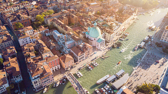 Drone Aerial view of iconic and unique Grand Canal crossing city of Venice with old tradition architecture as seen from above altitude
