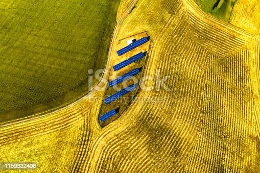 Drone aerial view of solar panel in cultivated fields