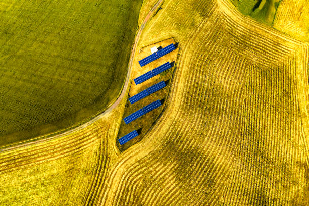 Drone aerial view of solar panel in cultivated fields stock photo