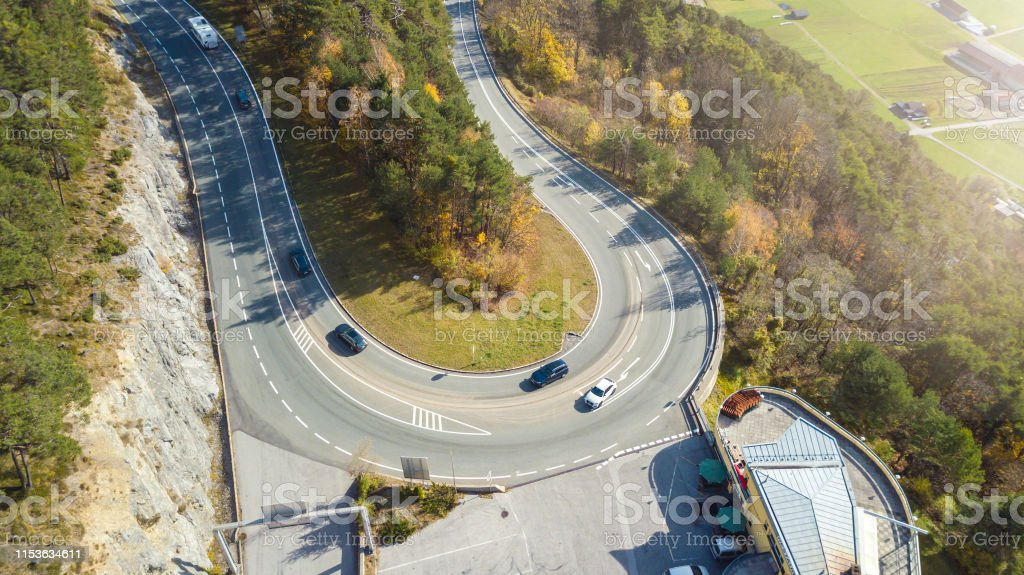 Drone Aerial View Of Street Coner Up Hill With Tree And Few Car Stock Photo Download Image Now Istock