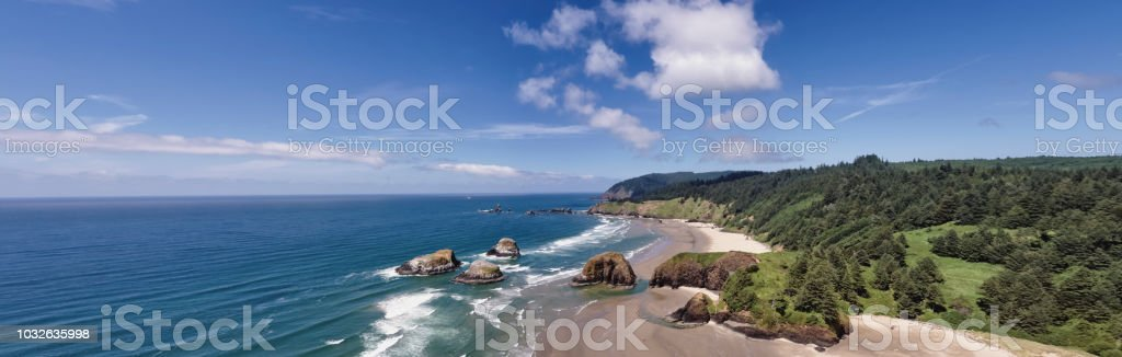 Drone aerial wide panorama shot at approximately 400 feet above Cannon Beach looking towards Ecola State Park on the Oregon Coast stock photo