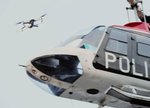 Drone and police helicopter - foto stock