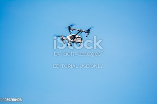 istock Drone at clear sky 1289259423