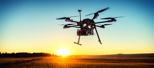 drone at sunset - drones stock photos and pictures
