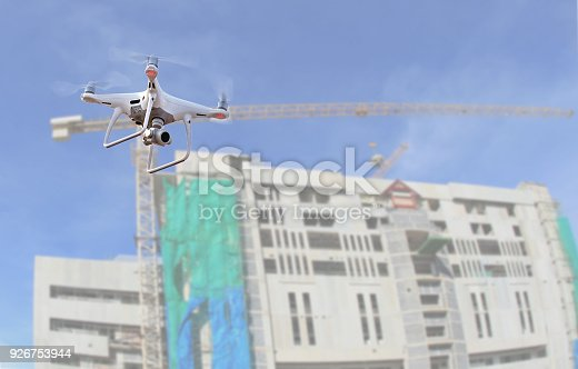 istock drone copter flying with digital camera.Drone with high resolution digital camera over construction site. 926753944