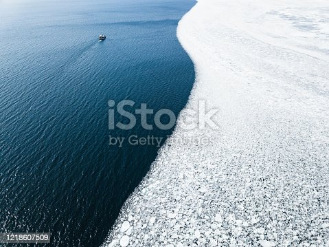Drone filming the melting of winter ice in Lake Ontario, Canada