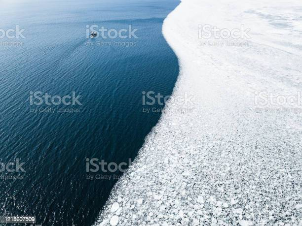 Photo of Drone filming the melting of winter ice in Lake Ontario, Canada
