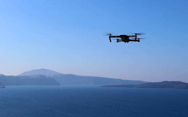 drone filming view of santorni island - drones stock photos and pictures
